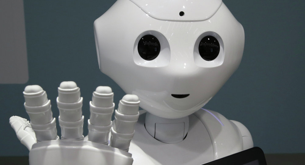 In this June 6, 2014 file photo, humanoid robot Pepper is on display at SoftBank mobile shop in Tokyo. Japanese mobile carrier Softbank said Tuesday, Feb. 10, 2015 it will incorporate artificial intelligence technology from IBM into its empathetic robot Pepper that goes on sale in Japan this month.