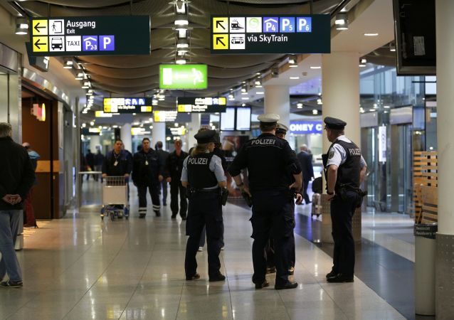 German police officers stand together in the terminal at Duesseldorf airport March 24, 2015.