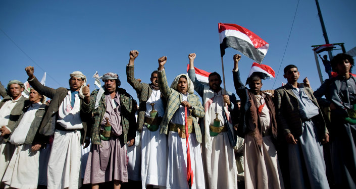 Houthi Shia Yemenis chant slogans during a rally to show support for their comrades in Sanaa, Yemen.