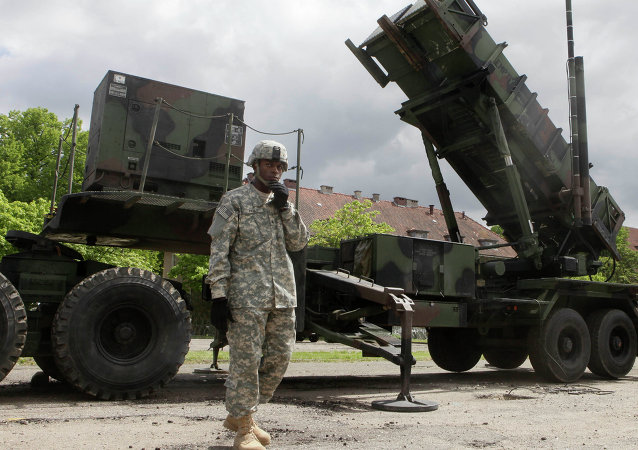 US soldier stands next to a Patriot surface-to-air missile battery at an army base in Morag, Poland.