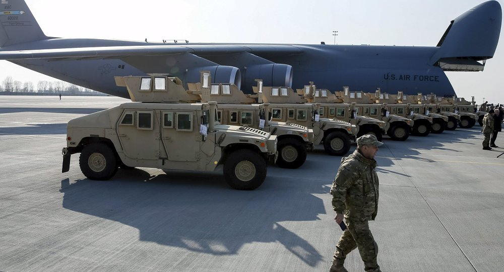 Ukrainian servicemen take part in a welcome ceremony for first plane from United State with non-lethal aid including ten Humvee vehicles to Ukraine at Borispol airport near Kiev, March 25, 2015.