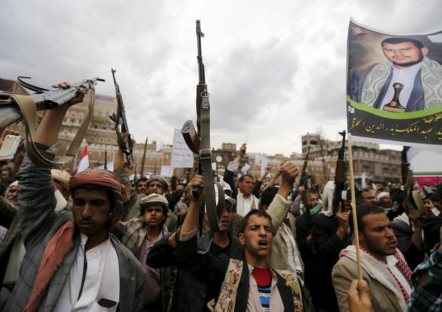 Shi'ite Muslim rebels holding up their weapons in a rally against Saudi-led airstrikes, Sana'a, Yemen