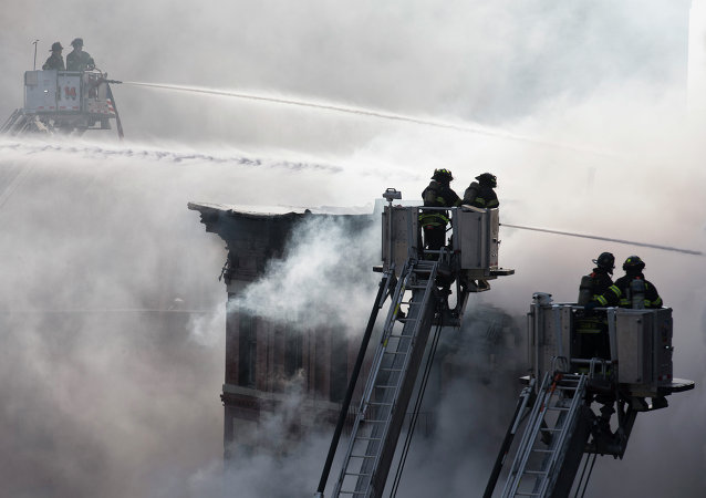 Firefighters spray water on a collapsed building in New York's East Village