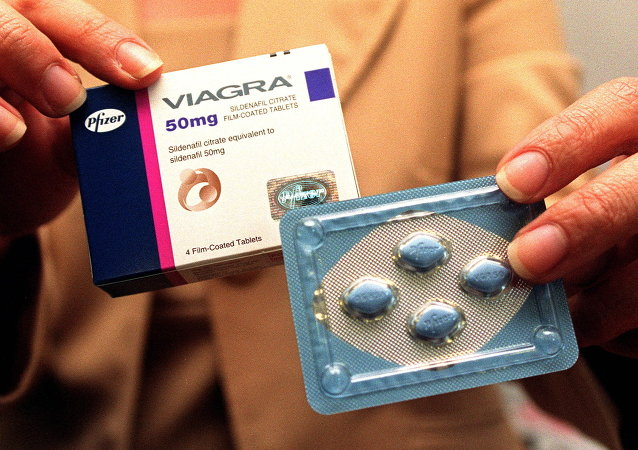 A public relation staff shows Viagra pills at a press conference in Singapore 19 April 1999