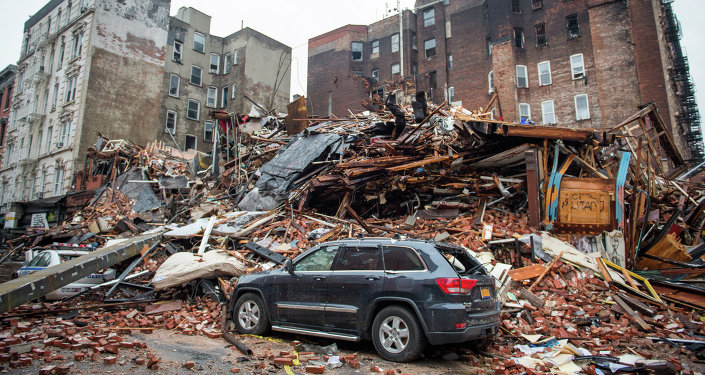 A pile of debris remains at the site of a building explosion in the East Village neighborhood of New York, Friday, March 27, 2015