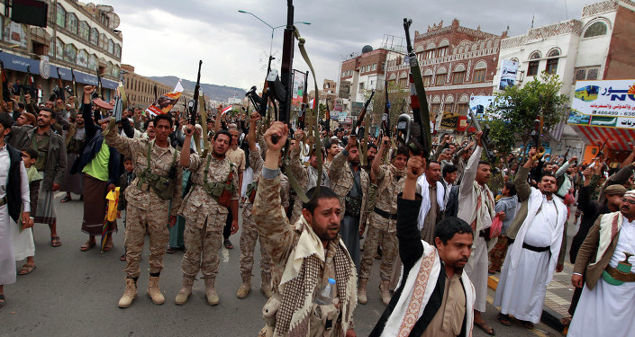 Shiite rebels, known as Houthis, hold up their weapons to protest against Saudi-led airstrikes, as they chant slogans during a rally in Sanaa, Yemen, Thursday, March 26, 2015