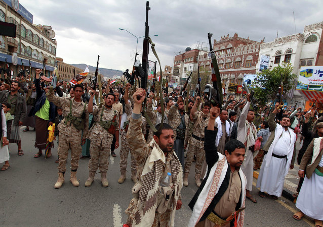 Shiite rebels, known as Houthis, hold up their weapons to protest against Saudi-led airstrikes, as they chant slogans during a rally in Sanaa, Yemen