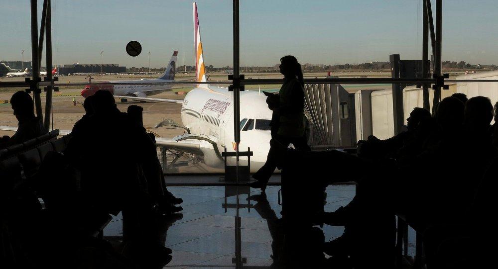 Passengers wait to board a Germanwings flight in Barcelona's El Prat airport March 27, 2015