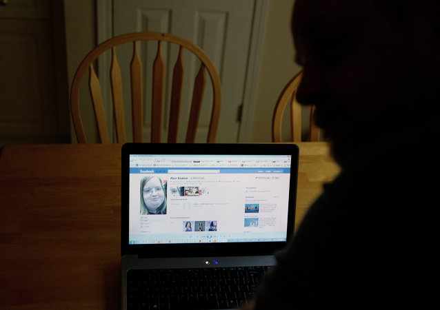 Chris Boston looks over a screen shot on his computer of the phony Facebook account that was set up in his daughter Alex's name Thursday, April 26, 2012, at their home in Acworth, Ga.