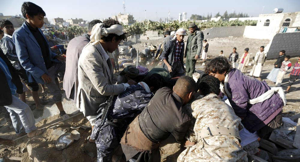 Rescuers search for survivors under the rubble of houses destroyed by an air strike near Sanaa Airport March 26, 2015