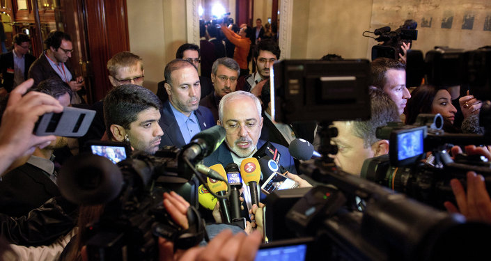 Iranian Foreign Minister Mohammad Javad Zarif (C) speaks to the press after meeting with the German and French foreign ministers in separate meetings at the Beau Rivage Palace Hotel in Lausanne on March 28, 2015