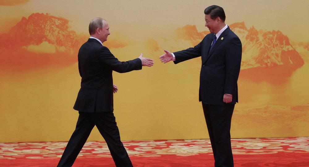Russian President Vladimir Putin, left, and Chinese President Xi Jinping