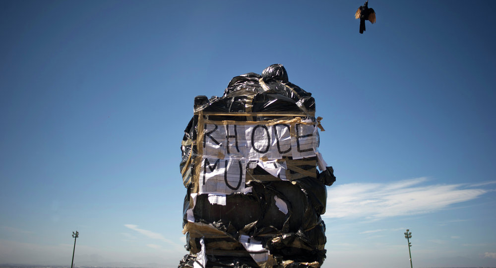 A statue of British coloniser Cecil John Rhodes is covered in plastic bags as part of a protest by students and staff of the University of Cape Town (UCT)