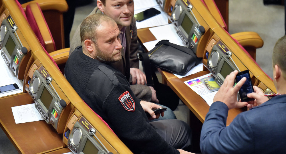 Ukrainian far-right Pravy Sektor (Right Sector) Dmytro Yarosh (C) poses for a picture during the opening of new parliamentary session in Kiev on November 27, 2014