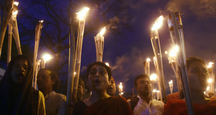 Bangladeshi secular activists take part in a torch-lit protest against the killing of US blogger of Bangladeshi origin and founder of the Mukto-Mona (Free-mind) blog site, Avijit Roy