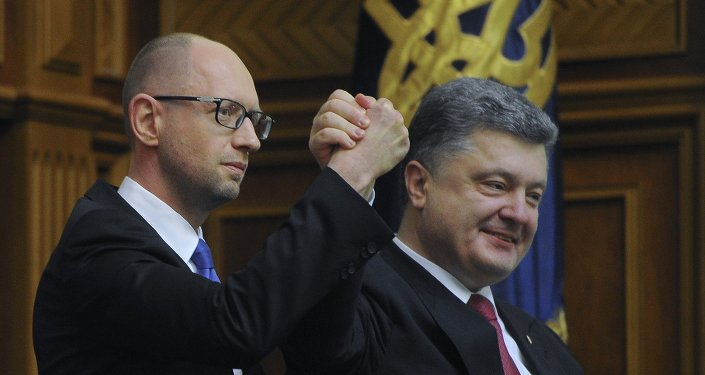 Ukraine's President Petro Poroshenko, right, celebrates with Arseniy Yatsenyuk after Yatsenyuk was appointed as Prime Minister during the opening first session of the Ukrainian parliament in Kiev