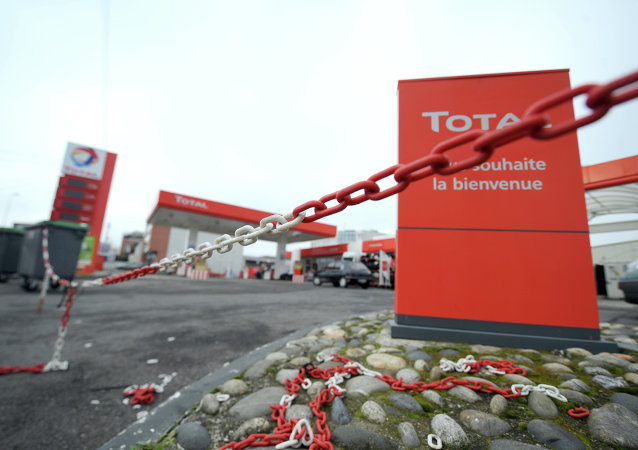 The closed entrance of an oil giant Total's filling station
