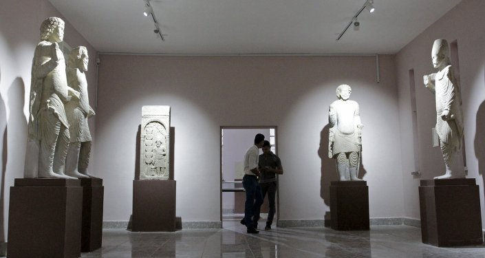 Iraqi men visit the Nassiriya Museum in Nassiriya province March 26, 2015. Nassiriya Museum has reopened for the first time since its closure in 1991 after it was looted during a Shi'ite uprising in southern Iraq. Picture taken March 26 2015