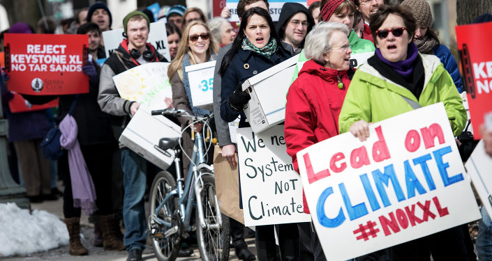 Activists march during a protest of the Keystone XL pipeline