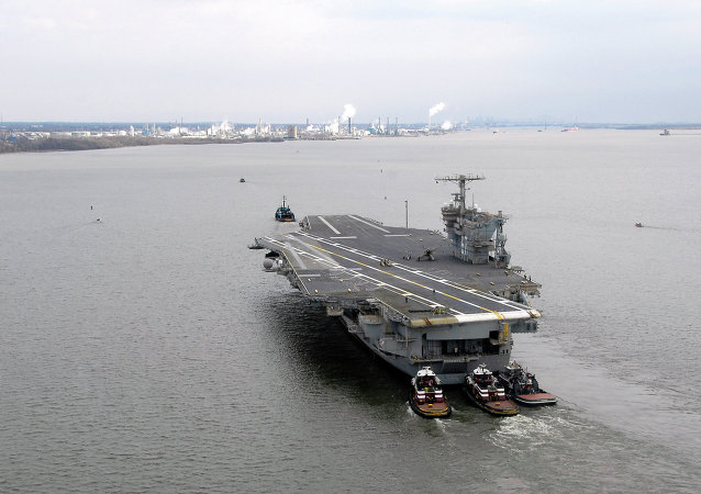 This photo supplied by the U.S. Coast Guard shows the decommissioned aircraft carrier USS John F.. Kennedy is towed Saturday, March 22, 2008, into the Port of Philadelphia