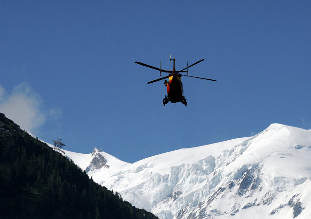 A rescue crew of the Securite Civile (emergency services) flies over French Alps