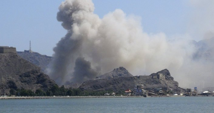 Smoke rises from an arms depot at the Jabal Hadeed military compound in Yemen's southern port city of Aden