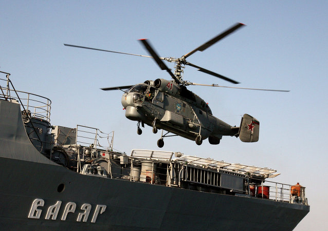 Anti-submarine helicopter Ka-27 hovering over the Guards' missile cruiser Varyag