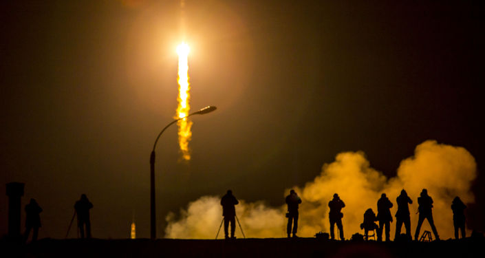 Media photograph the Soyuz TMA-16M spacecraft is seen as it launches to the International Space Station with Expedition 43 NASA Astronaut Scott Kelly, Russian Cosmonauts Mikhail Kornienko, and Gennady Padalka of the Russian Federal Space Agency (Roscosmos) onboard Saturday, March 28, 2015, Kazakh time (March 27 Eastern time) from the Baikonur Cosmodrome in Kazakhstan. As the one-year crew, Kelly and Kornienko will return to Earth on Soyuz TMA-18M in March 2016