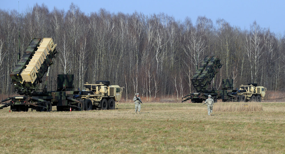 US troops from the 5th Battalion of the 7th Air Defense Regiment emplace a launching station of the Patriot air and missile defence system at a test range in Sochaczew, Poland