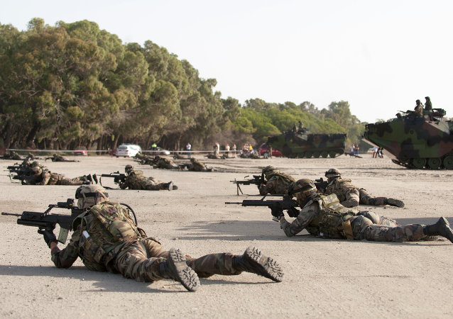 Spanish Navy Marines take position during a NATO Response Force training exercise.