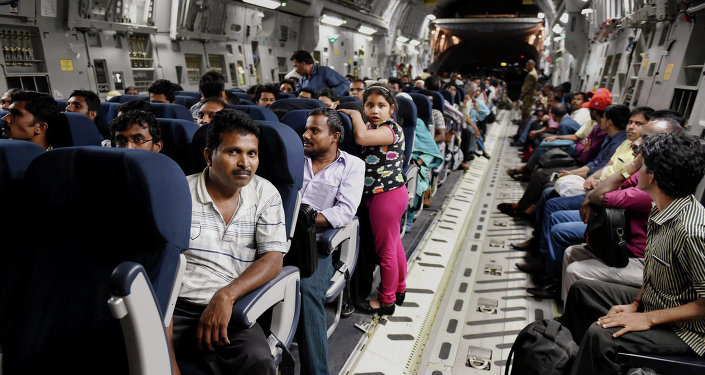 Indians evacuated from Yemen sit inside the Indian Air Force C17 Globemaster aircraft upon their arrival at Chhatrapati Shivaji International Airport in Mumbai, India, Thursday, April 2, 2015