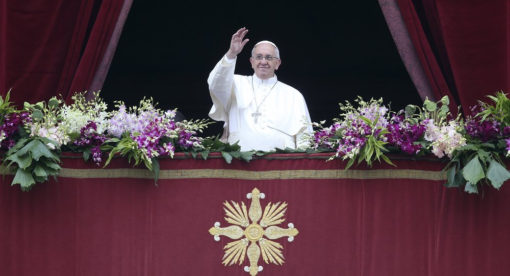 Pope Francis waves as he delivers a Urbi et Orbi message from the balcony overlooking St. Peter's Square at the Vatican April 5, 2015
