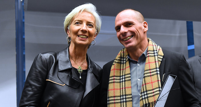 Greek Finance Minister Yanis Varoufakis (R) shakes hands with International Monetary Fund (IMF) Director Christine Lagarde during an emergency Eurogroup finance ministers meeting at the European Council in Brussels on February 11, 2015