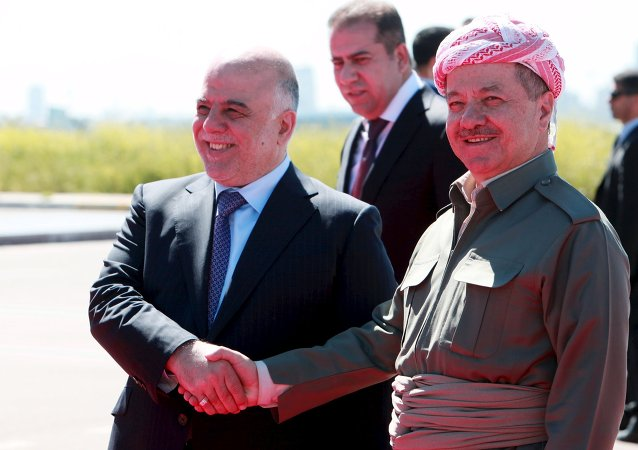 Iraqi Kurdish regional President Massoud Barzani (R) shakes hands with Iraqi Prime Minister Haider al-Abadi at Arbil International Airport April 6, 2015
