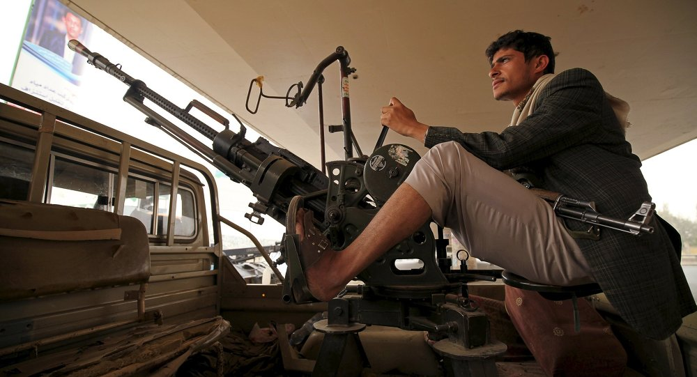 A Houthi fighter mans a weapon on a patrol truck as he guards the site of a demonstration against Saudi-led coalition airstrikes, in Sanaa April 3, 2015