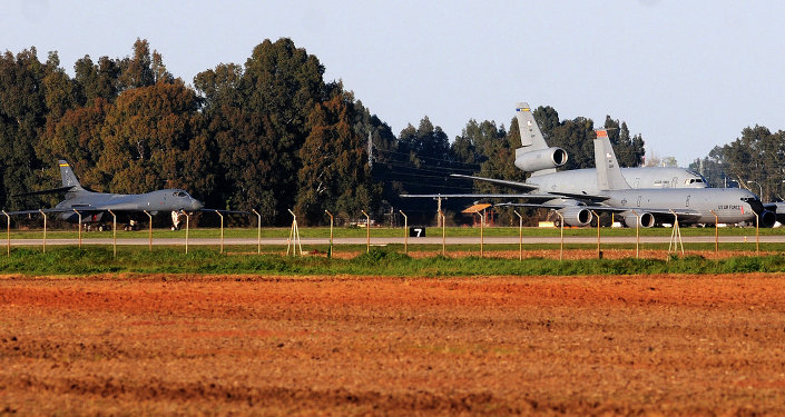 US B1 bomber (L) and tanker aircraft KC135R and KC1O are seen in the air base, in Moron de la Frontera, on March 18, 2011, near Sevilla