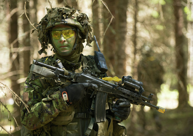 Estonian soldiers take part in an annual military exercise together with several units from other NATO member states on May 18, 2014 near Voru close to the Estonian-Russian border in South Estonia