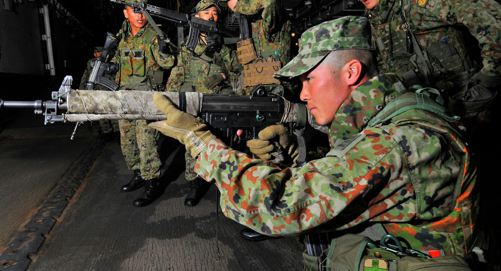 Members of the Japan Ground Self Defense Force conduct small arms weapons training aboard U.S. Navy's amphibious assault ship USS Peleliu.