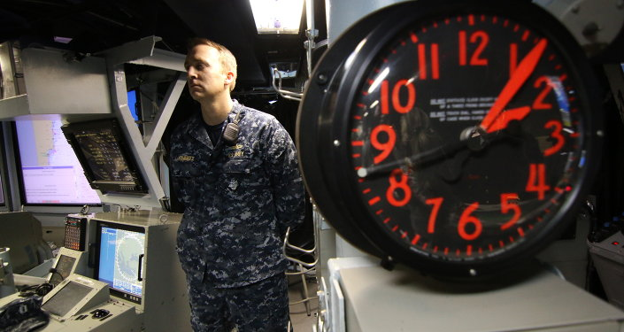 A United States Navy sailor stands guard on board a US Navy destroyer.