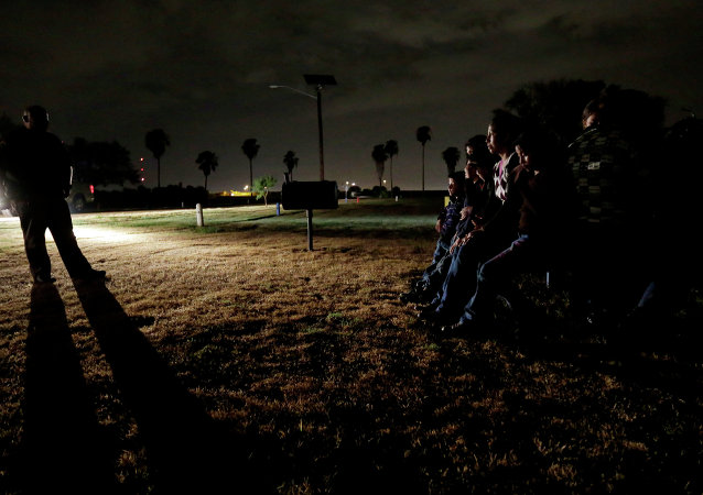 A group of immigrants from Honduras and El Salvador, who crossed the U.S.-Mexico border illegally, are stopped in Granjeno, Texas