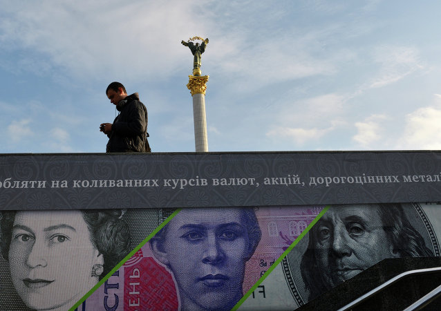 A man stands next to an advertising placard showing British pounds, US dollars and Ukrainian hryvnia banknotes in the Ukrainian capital Kiev, file photo.