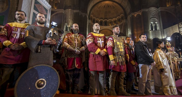 Men dressed as Serbian knights attend an Orthodox Easter service in the St. Sava temple in Belgrade