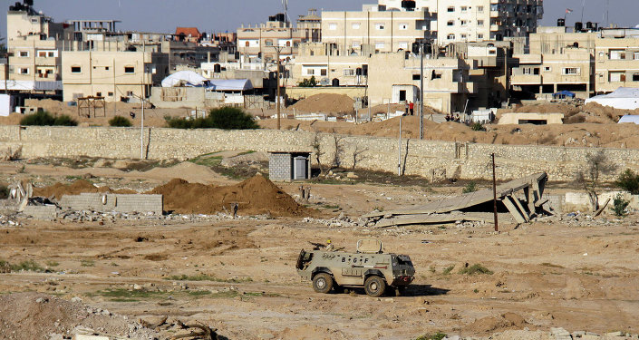 Egyptian army armored vehicle stands on the on the Egyptian side of border town of Rafah, north Sinai, Egypt