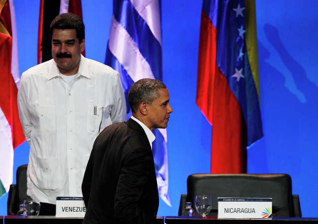 President Barack Obama walks past the empty seat of Nicaragua as he leaves the opening ceremony of the sixth Summit of the Americas after shaking hands with Venezuela's Prime Minister Nicolas Maduro, left, in Cartagena, Colombia, Saturday April 14, 2012