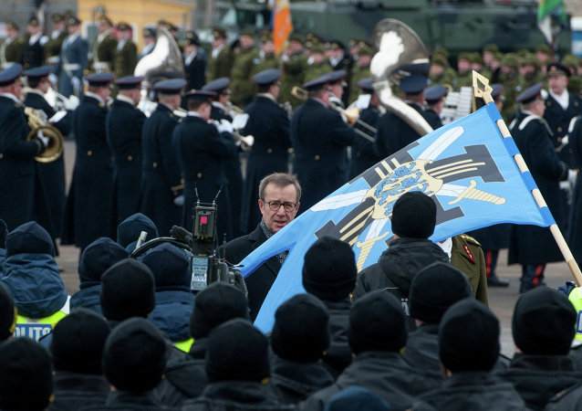 Estonian President Toomas Hendrik Ilves reviews the troop ahead of a military parade to celebrate 97 years since first achieving independence in 1918