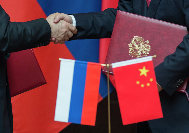 China intends to further enhance e-commerce cooperation with Russia, Chinese Commerce Ministry spokesman Sun Jiwen said Thursday.