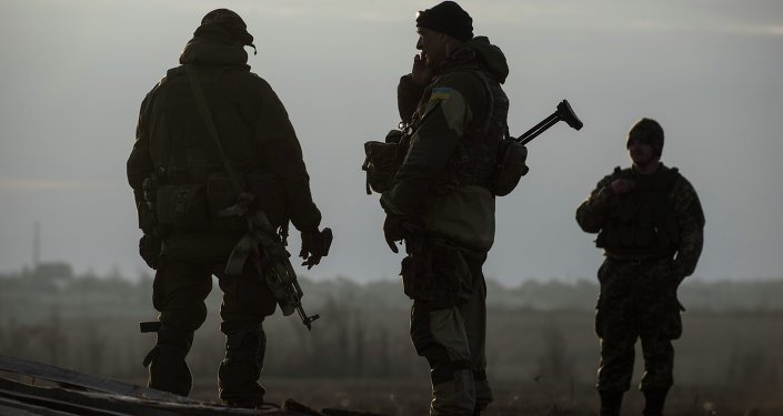 Ukrainian servicemen guard their position in the village of Shyrokyne near Mariupol, eastern Ukraine, Wednesday, Feb. 25, 2015