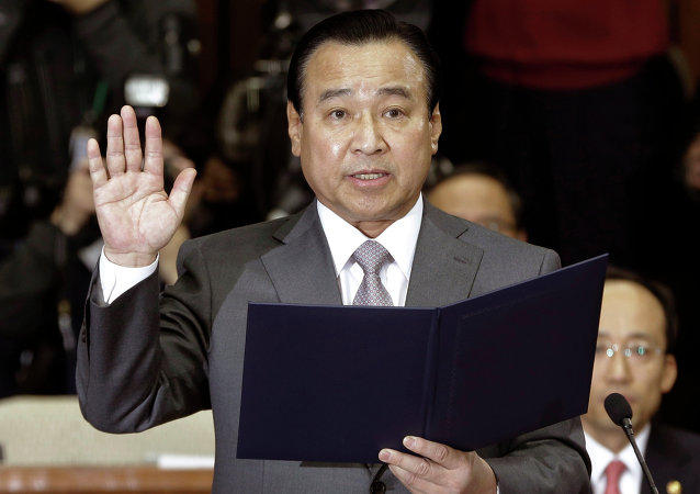 In this Tuesday, Feb. 10, 2015 file photo, South Korea's new Prime Minister nominee Lee Wan Koo swears an oath during a confirmation hearing in order to examine his qualification at the National Assembly in Seoul, South Korea