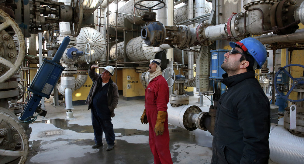 Iranian oil workers work at the Tehran's oil refinery south of the capital Tehran, Iran, Monday, December 22, 2014.