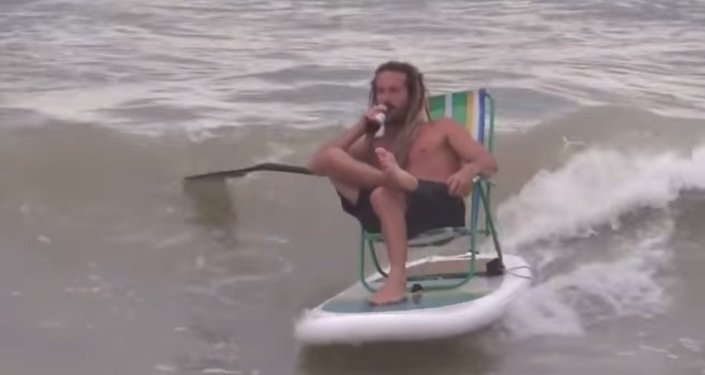 Super Casually Lounges while Drinking a Beer… On a Wave!